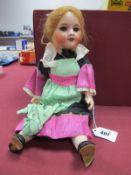 An Early XX Century Bisque Headed Doll, with open mouth and closing eyes, composition body stamped