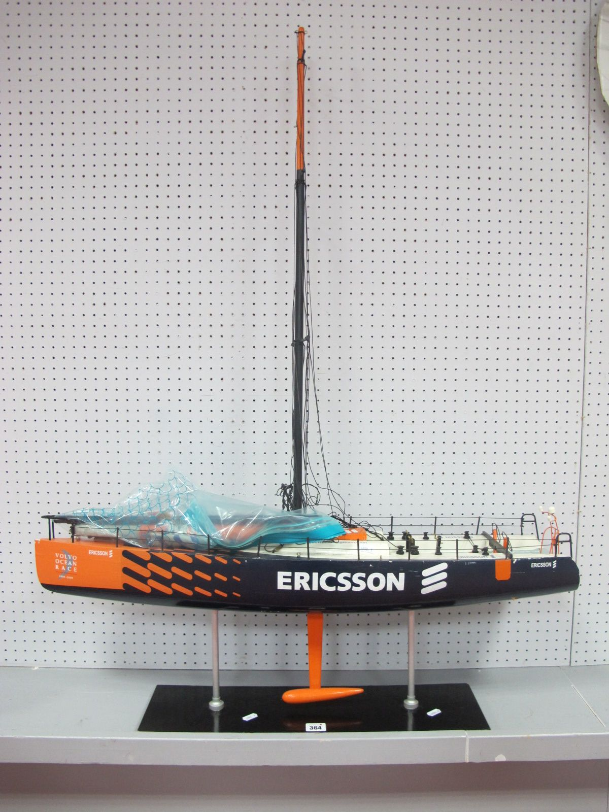 A Static Display Model of a Volvo Ocean Race Competitor, with Ericsson blade, orange livery,
