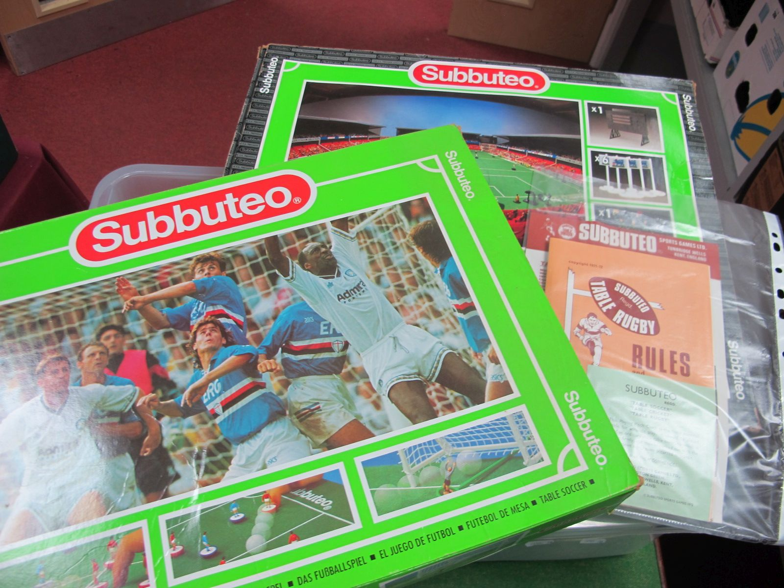Subbuteo: Two Boxed Subbuteo Games, unchecked, Subbuteo papers and a tin of playing cards.