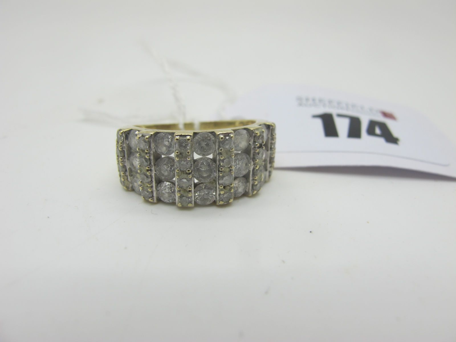 A Modern 9ct Gold Diamond Set Dress Ring, of wide graduated design, set throughout with alternate