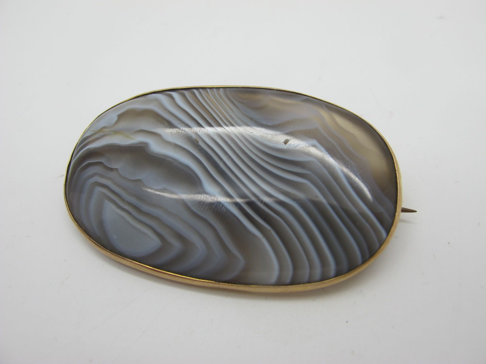 A Large Hardstone Oval Panel Brooch, collet set.