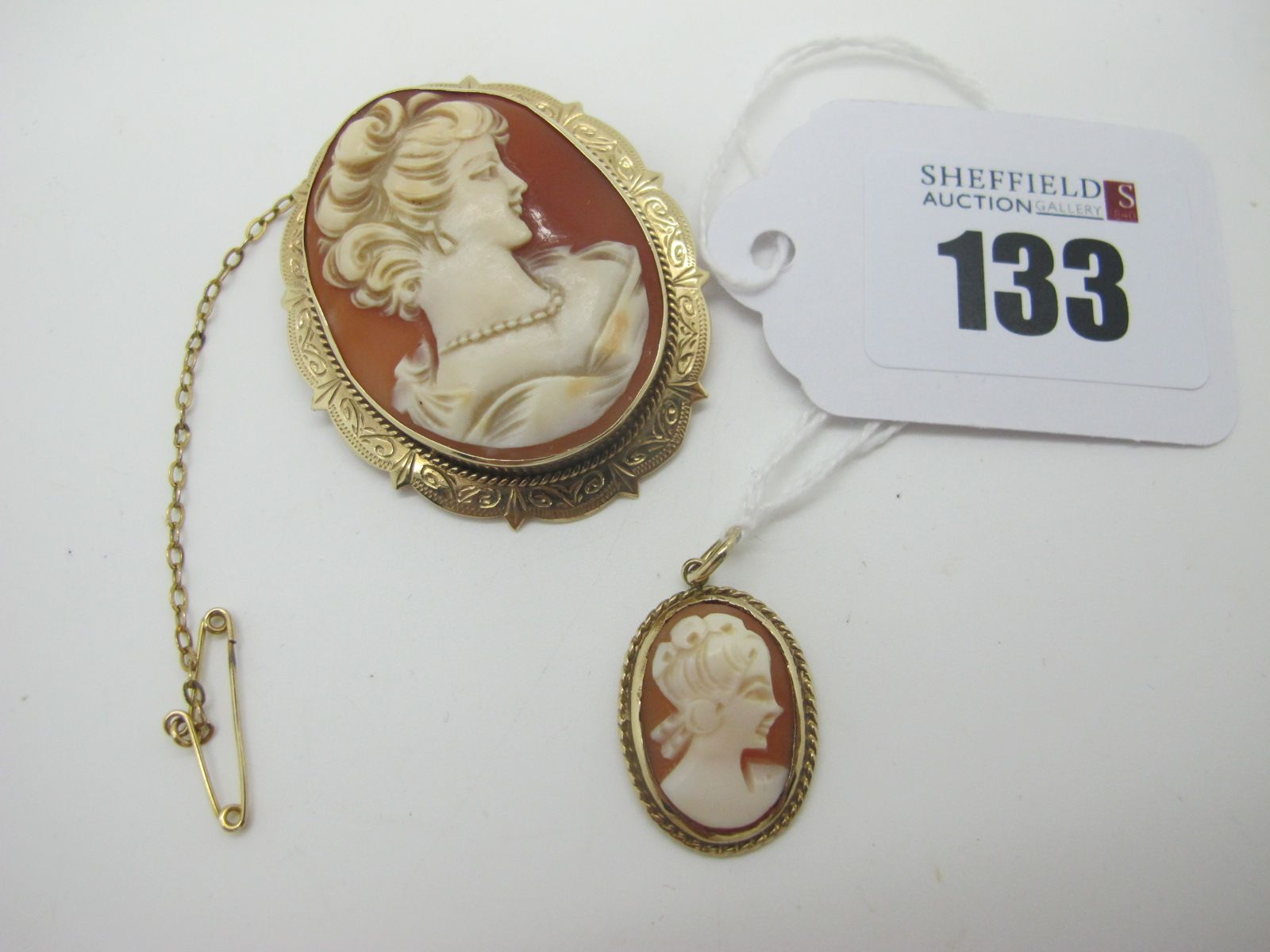 A 9ct Gold Oval Shell Carved Cameo Brooch, depicting female profile, within shaped and engraved