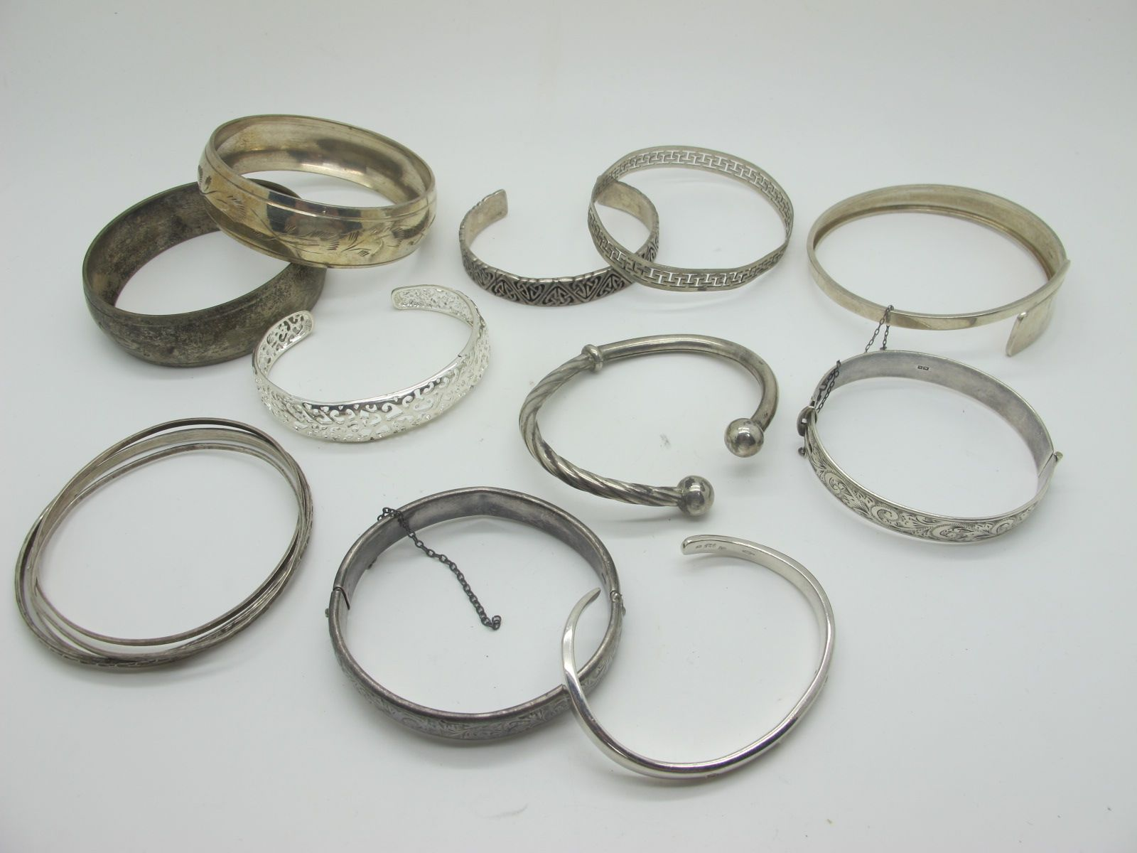 """A Collection of Hallmarked Silver, """"925"""" and Other Bangles, including hinged examples with scroll"""