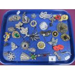 A Selection of Costume Brooches, including lucite style, diamanté, floral style, dress clips