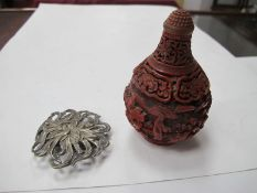 A Modern Cinnabar Red Lacquer Style Chinese Snuff Bottle and Stopper, decorated with figures in