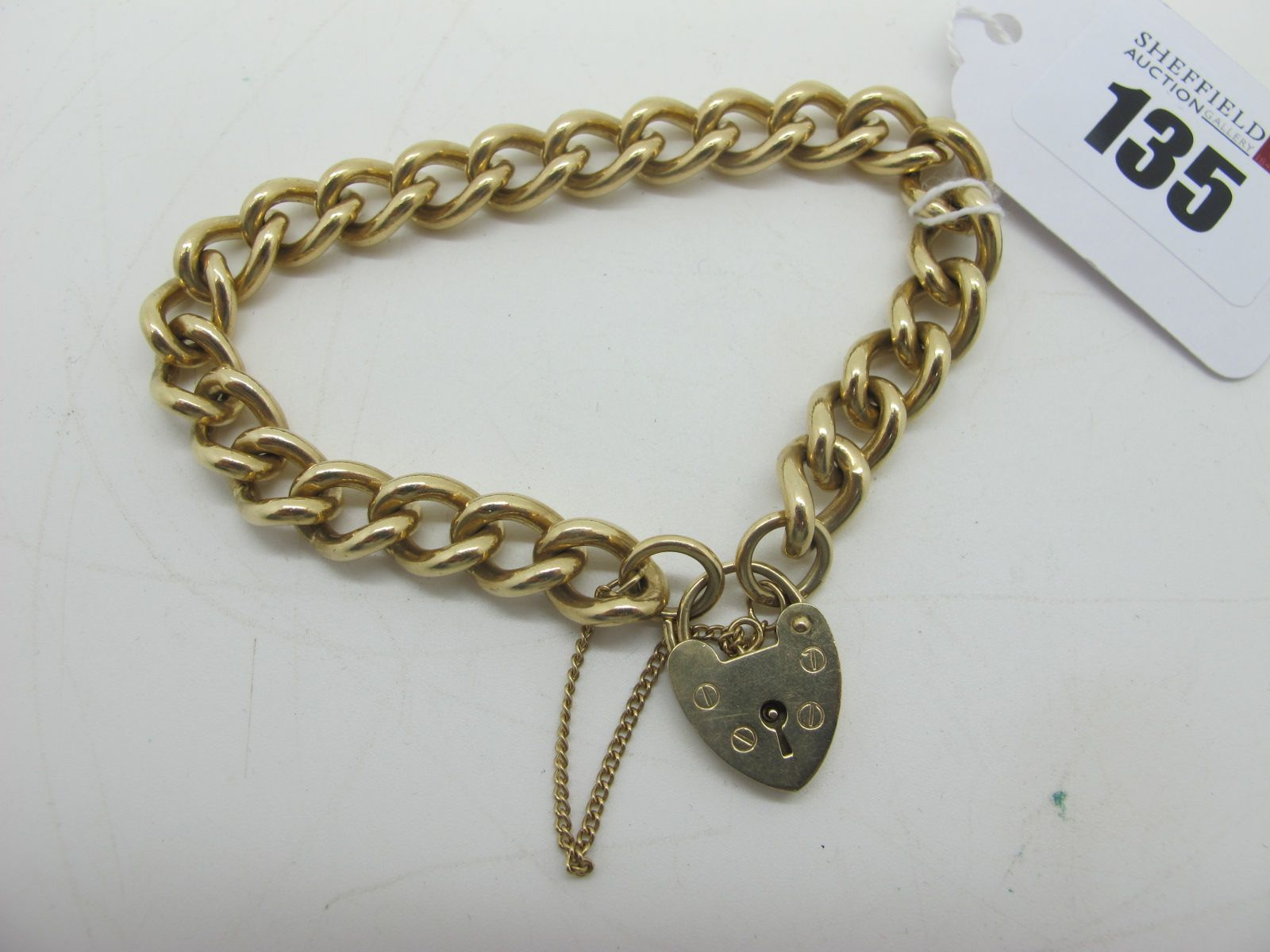 A 9ct Solid Gold Curb Link Bracelet, to heart shape padlock style clasp.