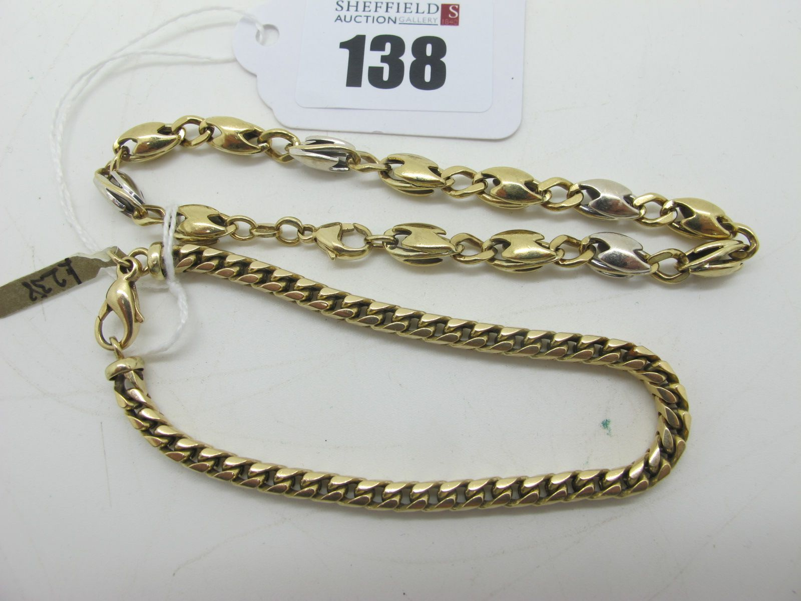 A 9ct Gold Bracelet, together with a fancy link 9ct two colour gold bracelet. (2)