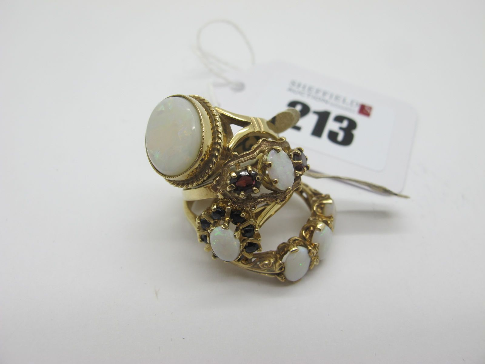 A Modern 9ct Gold Opal Set Dress Ring, (finger size M); together with a 9ct gold three stone opal