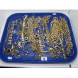 A Selection of Gilt Colour Costume Jewellery, fancy chains, bangles, bead necklaces, ornate pendants