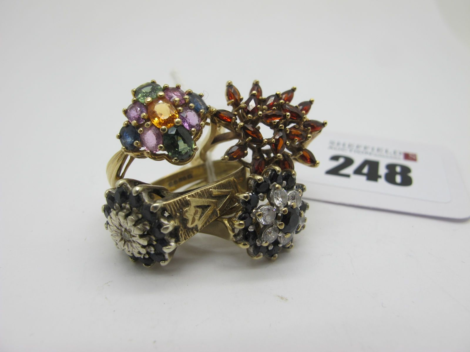 A 9ct Gold Cluster Dress Ring, of abstract design, claw set (finger size K1/2); together with