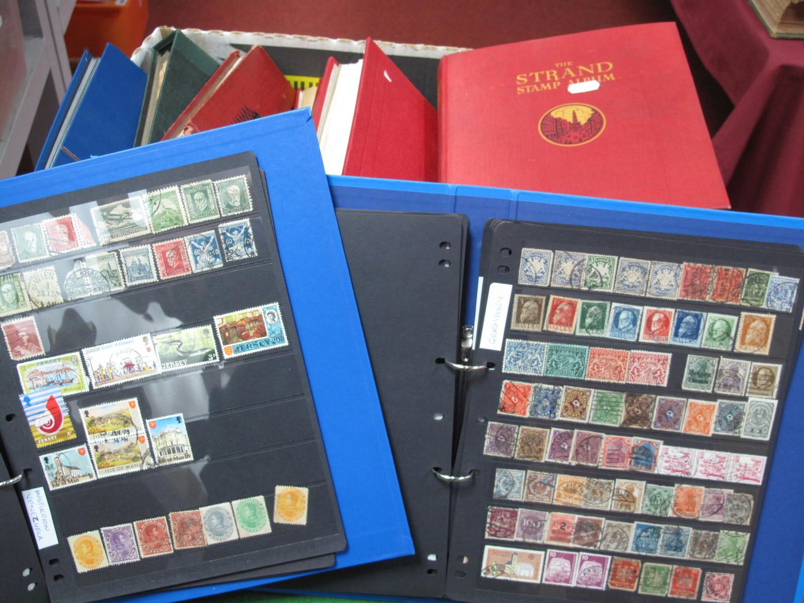 A Carton of Nine Junior Albums and Stockbook of World Stamps, most Countries represented including