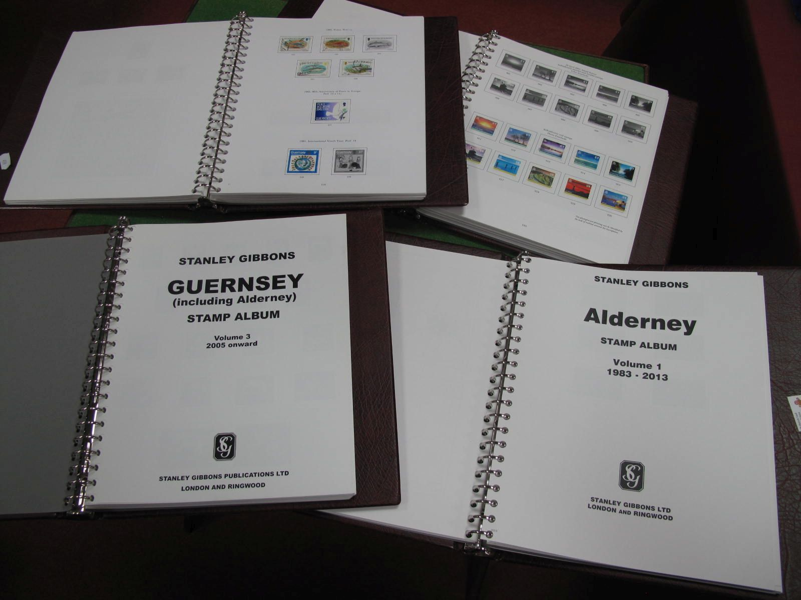 Guernsey Four Stanley Gibbons Printed Albums, mainly unused but includes a few sets, singles, etc.