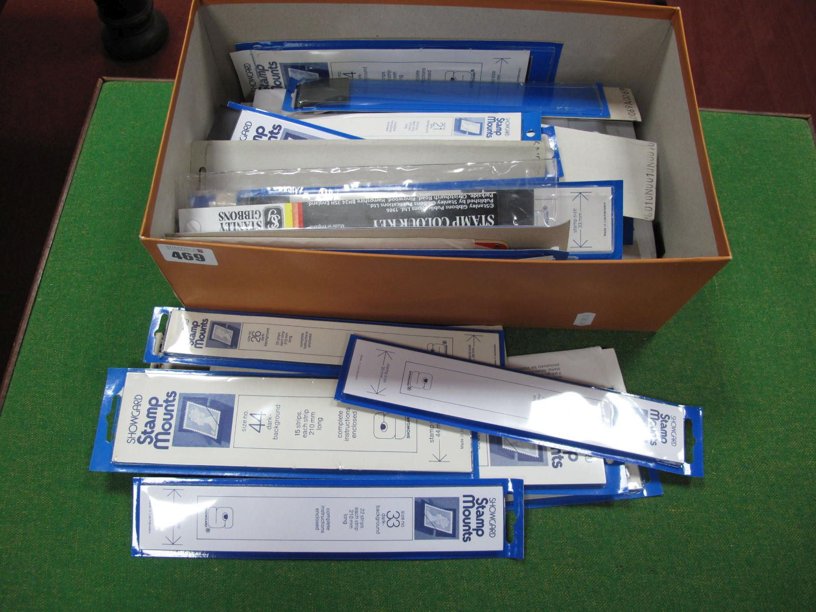 A Shoe Box Full of Showgard Stamp Mount Strips, from size 21mm to 55mm +, many hundreds of strips