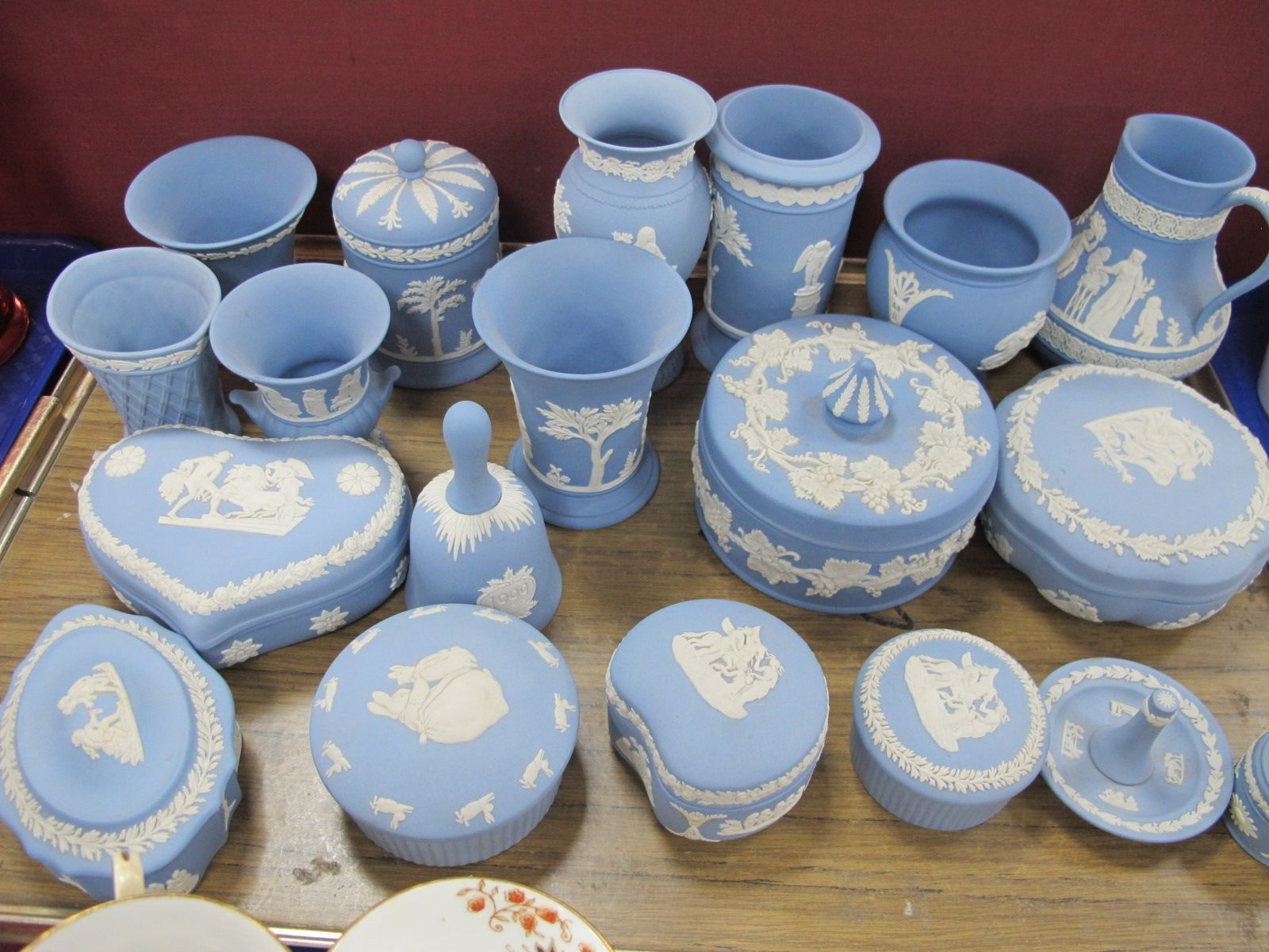 Wedgwood Powder Blue Jasper Ware Pottery, of nineteen pieces, including vases, heart shaped and
