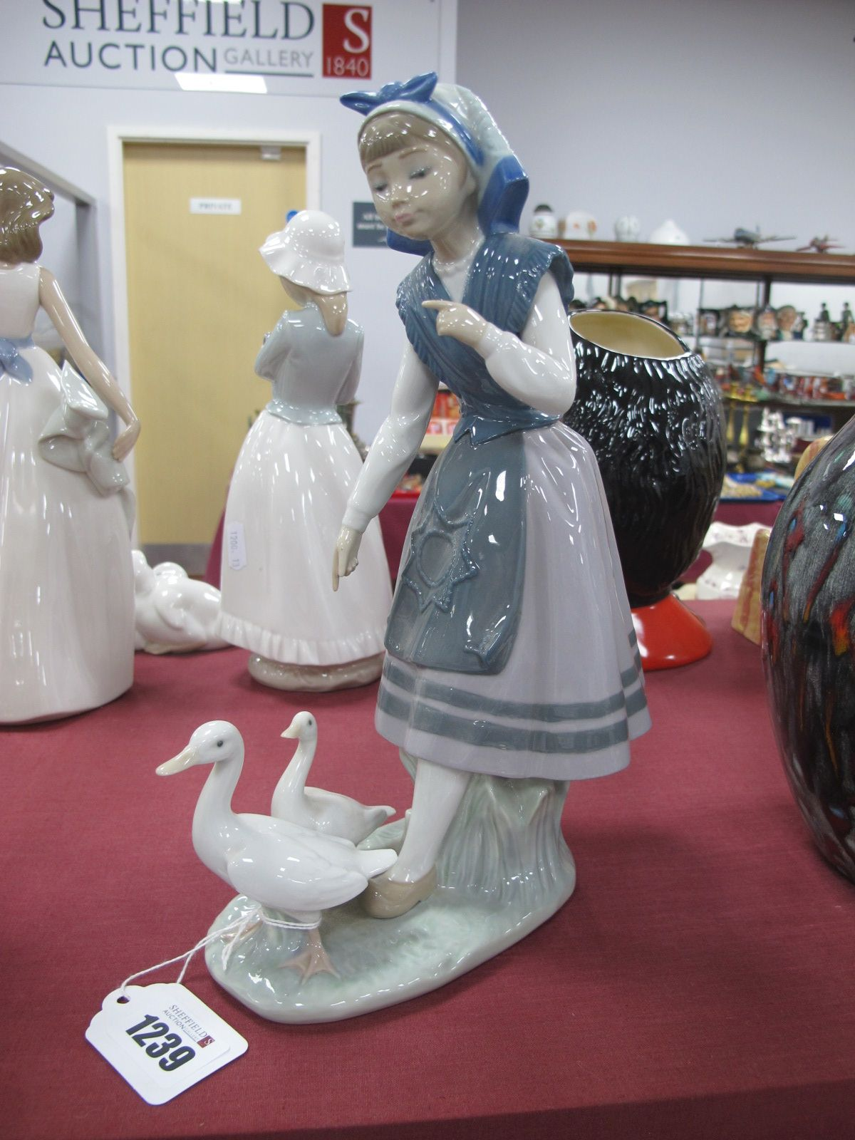 A Lladro Figurine of Girl Following Geese, stamped 5202, B-12D, 26.5cm high.