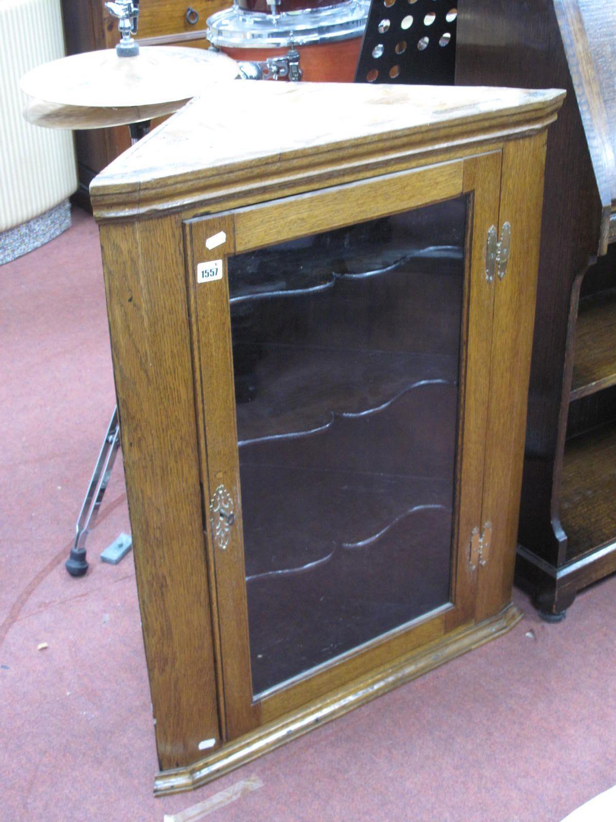 A XIX Century Oak Glazed Flat Fronted Corner Cupboard, with three internal shelves.