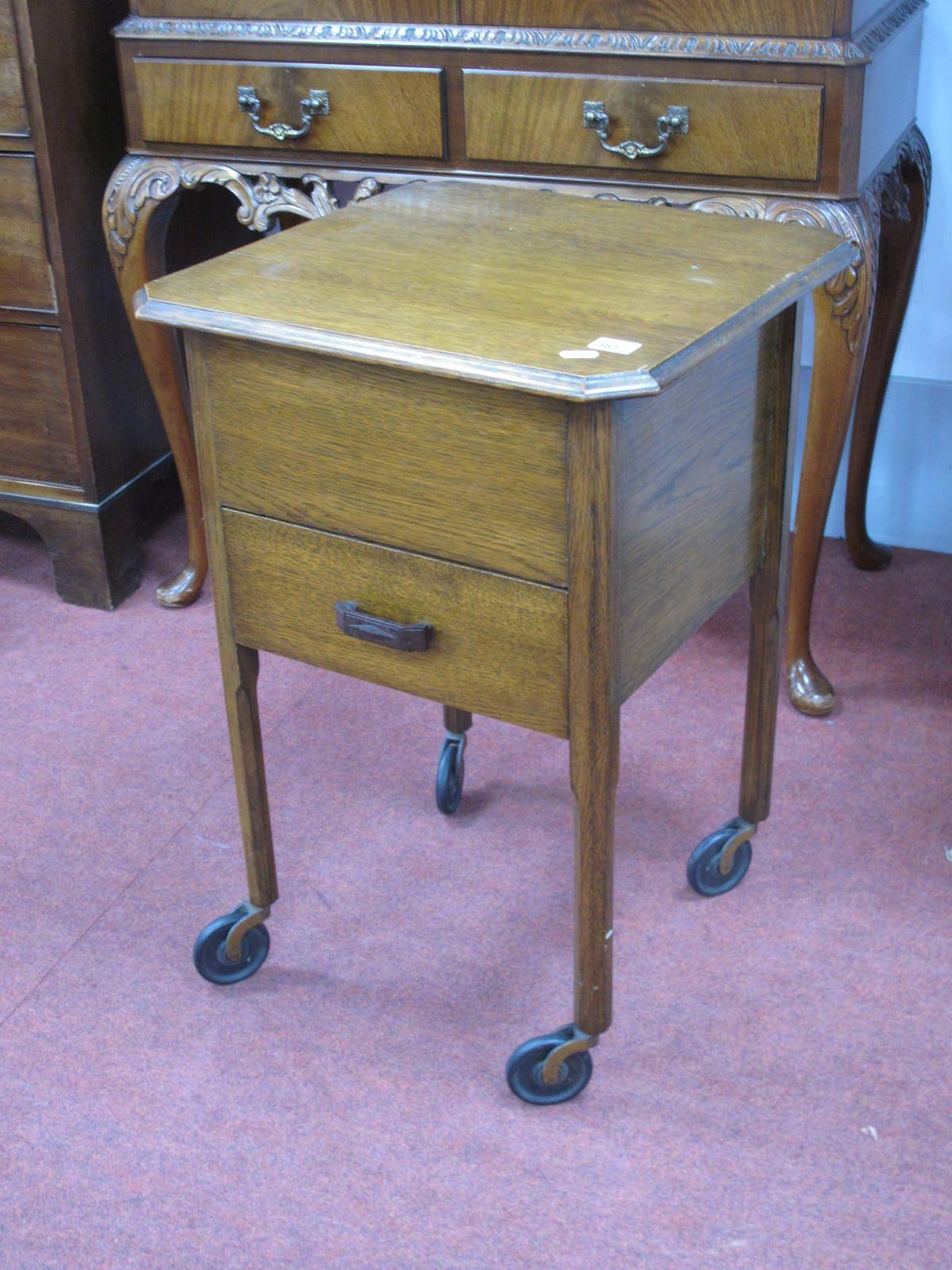 A Watts of Sheffield Oak Needlework Table, circa 1920's with lift up top over single drawer, 45.