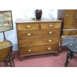 An Early XIX Century Mahogany Chest of Drawers, the top with a moulded edge, two short drawers,