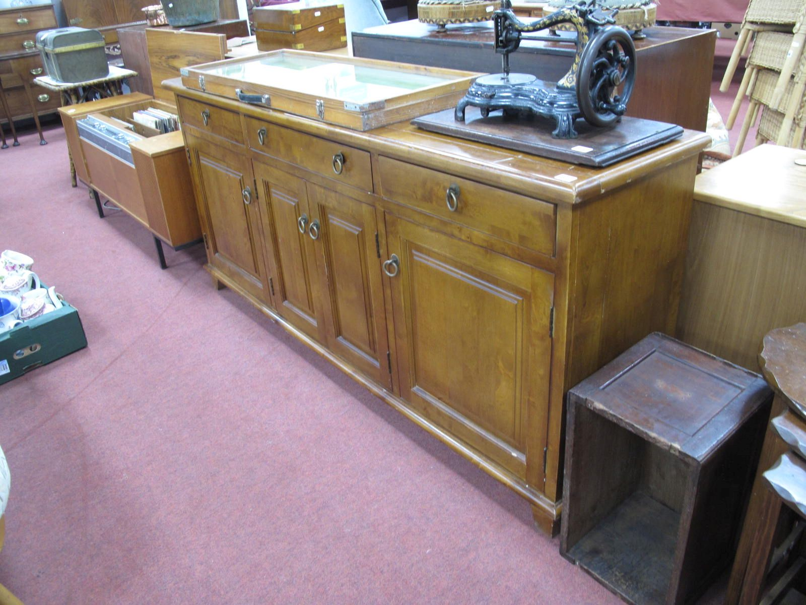 A Rustic Sideboard, with three drawers over four cupboard doors, 178cm wide.