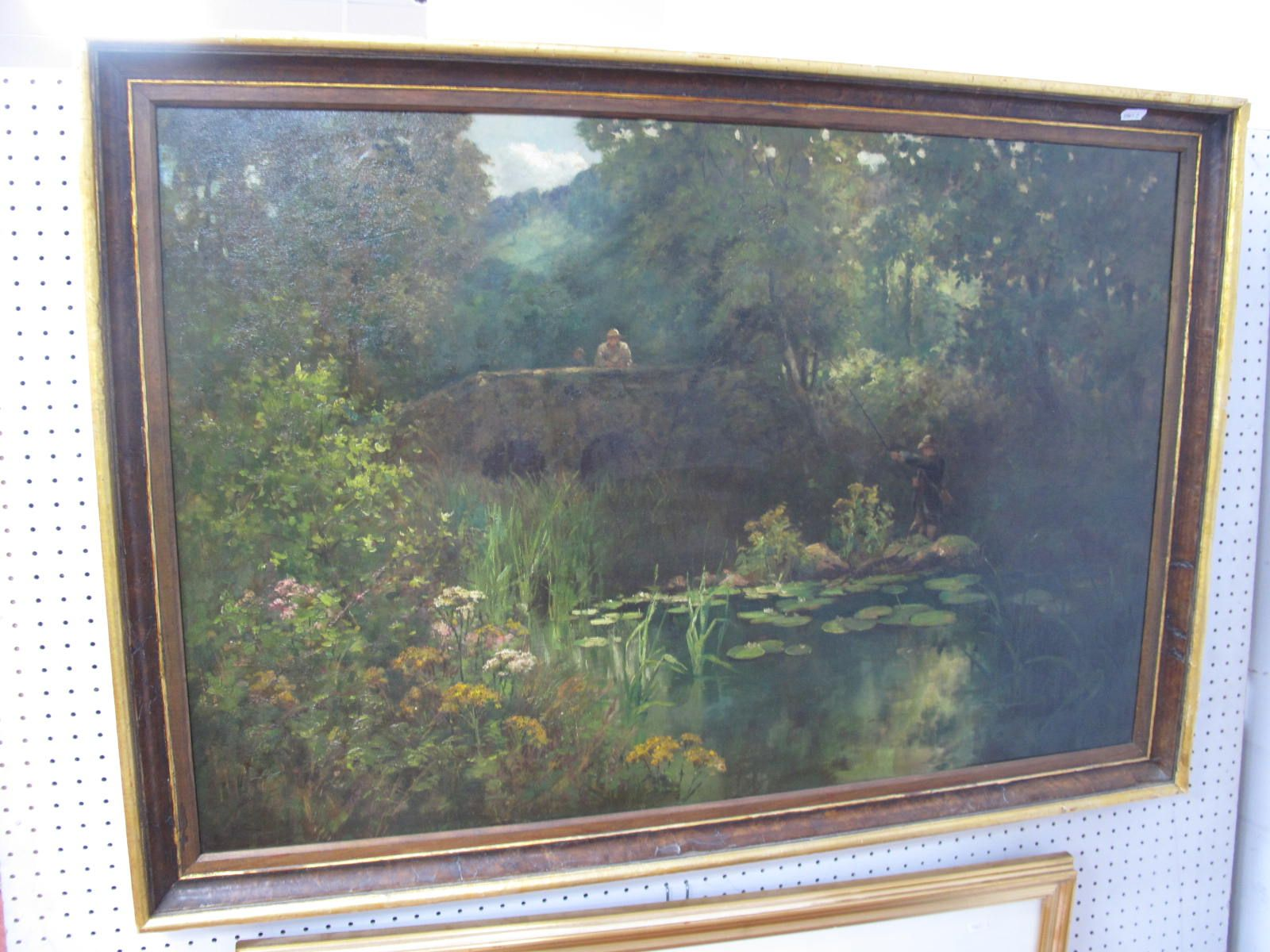 An Early XX Century Oil on Canvas, of a man fishing in a pond, with a man leaning on bridge, (