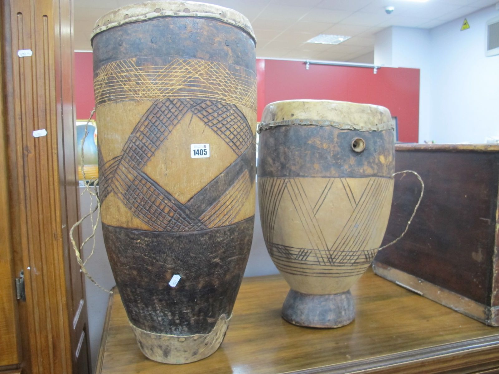 Two African XX Century Bemba Kasama Drums, with scratch decoration, possibly from Zambia, highest