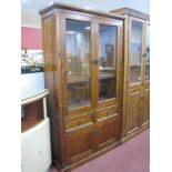 A Pine Effect Display Cabinet/Bookcase, with glazed doors, two internal shelves, two small drawers