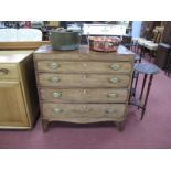 An Early XIX Century Mahogany Straight Front Chest of Four Graduated Drawers, having brass handles