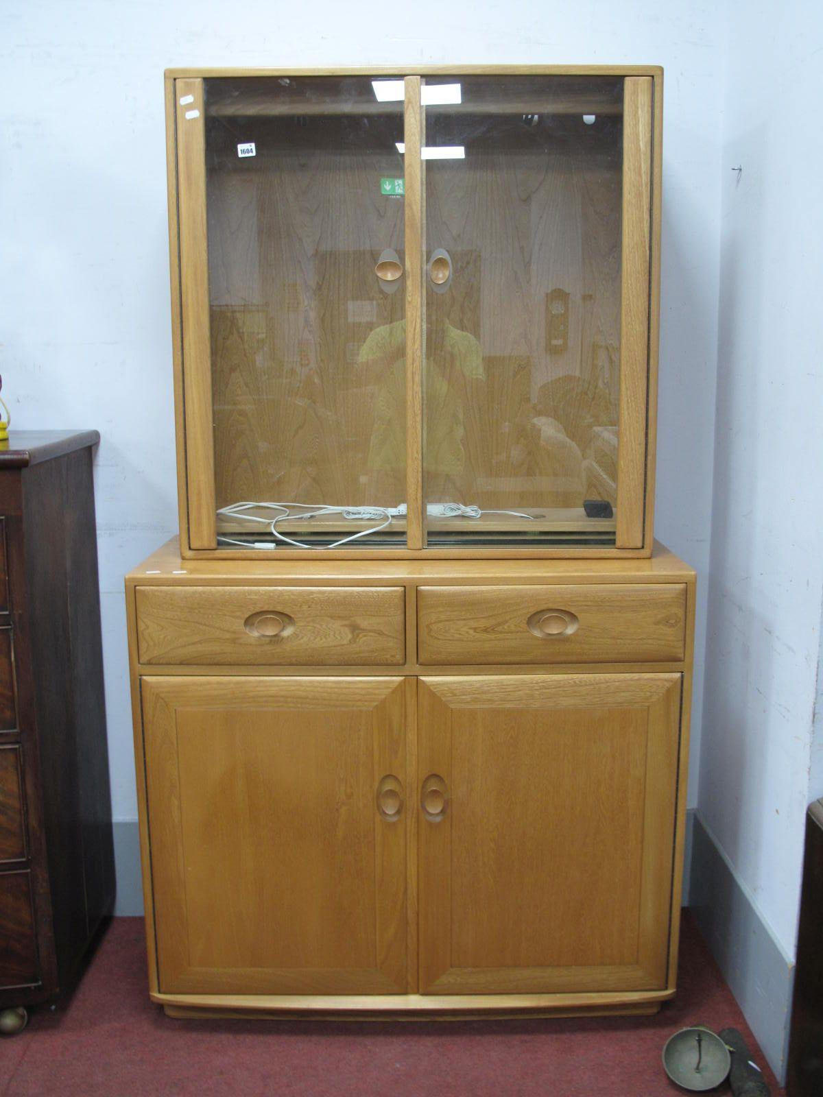 An Ercol Display Cabinet, top with glazed doors,the base with two short drawers over two cupboard
