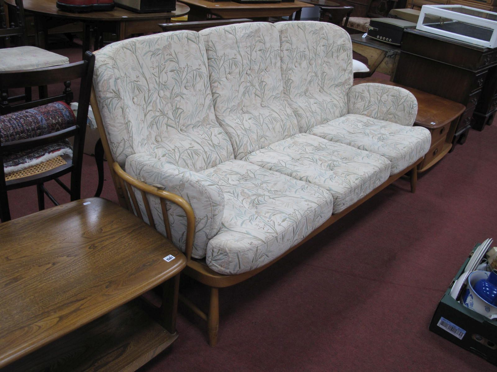Ercol Light Wood Three Seater Settee, having rail back and splayed squat feet, approximately 192cm
