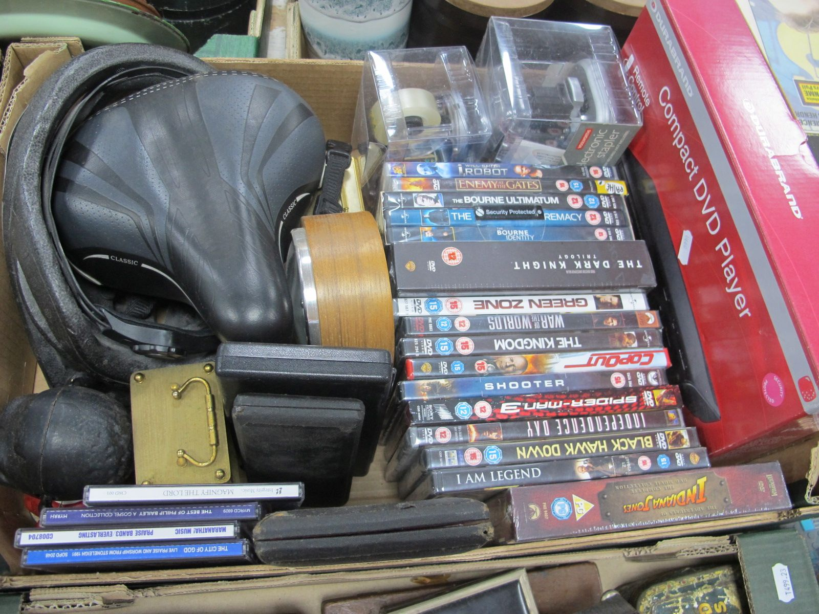 Riefler and Other Geometry Implements, cyclists helmet and saddle, dvd player and discs, Jolly money