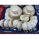 Tuscan Plant Tea Ware, of thirty three pieces, gilt scrollwork with green dot decoration on cream