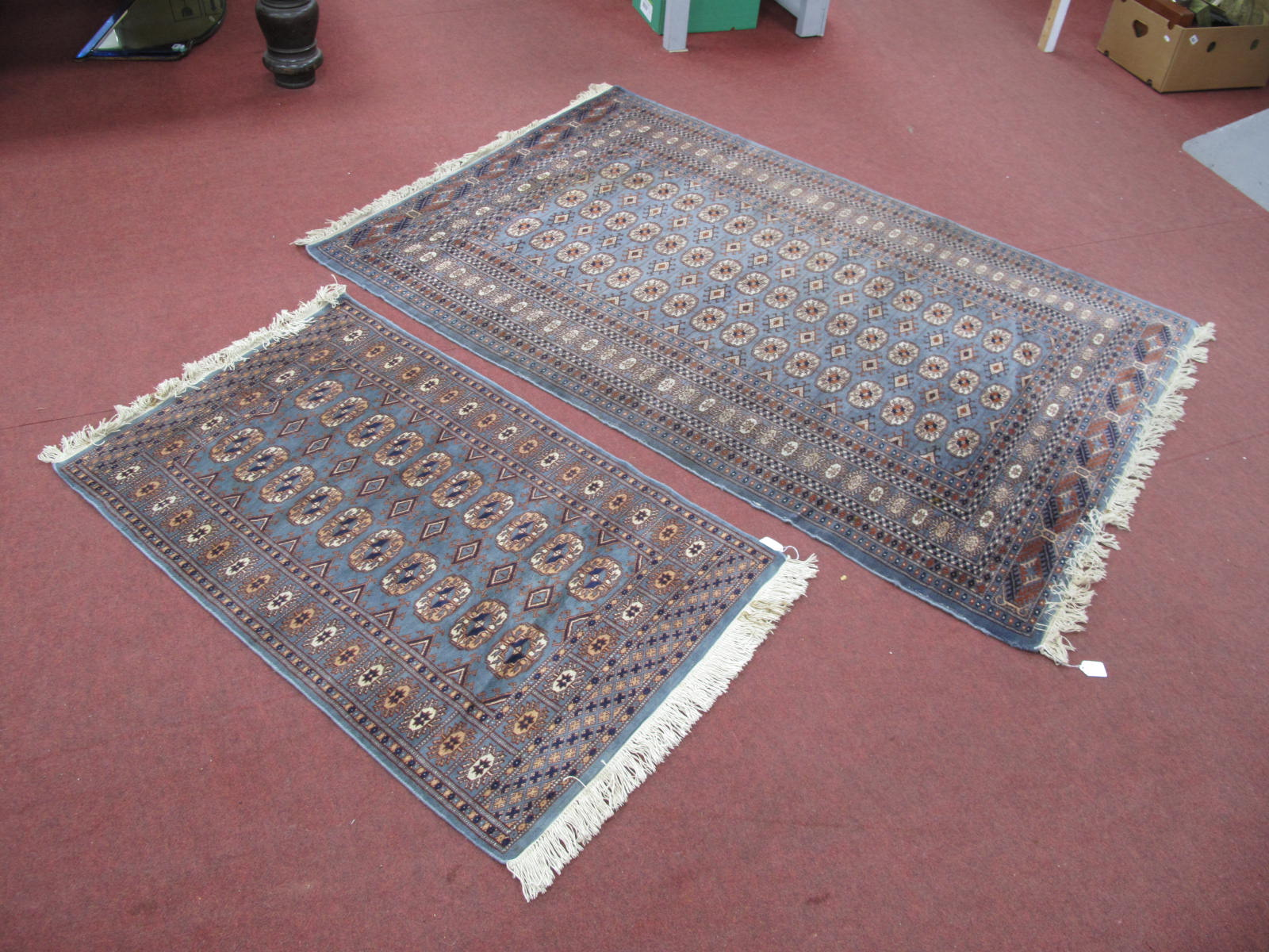 A Middle Eastern Wool Tasselled Rug, with three rows, of sixteen medallions to centre on slate - Image 2 of 2