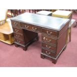A Mahogany Effect Pedestal Desk with inset scriver to flat top, an arrangement of eight drawers