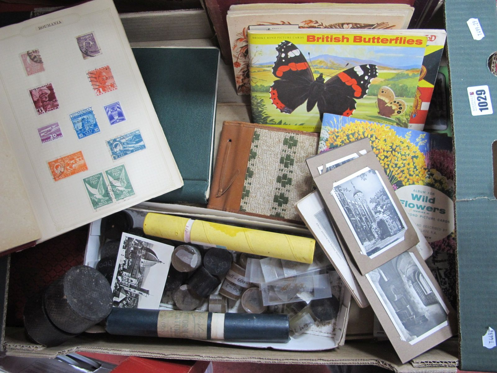 Early XX Century Postcards, stamp albums, Brooke Bond albums, slides, etc:- One Box.