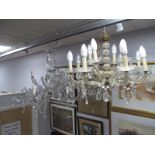 An Eight Branch Glass Chandelier, with four upper branches, having faceted and pear shape drops,