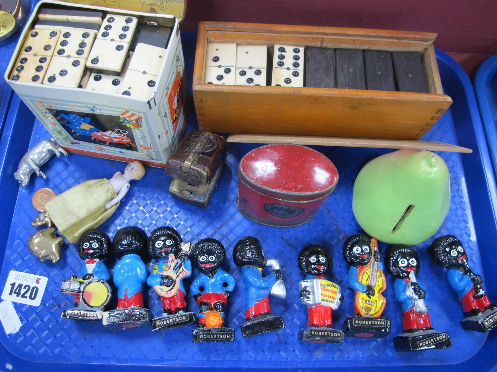 Nine Robertsons Bandsmen, inkwell as a Doctors bag, dominoes, small doll, etc:- One Tray.