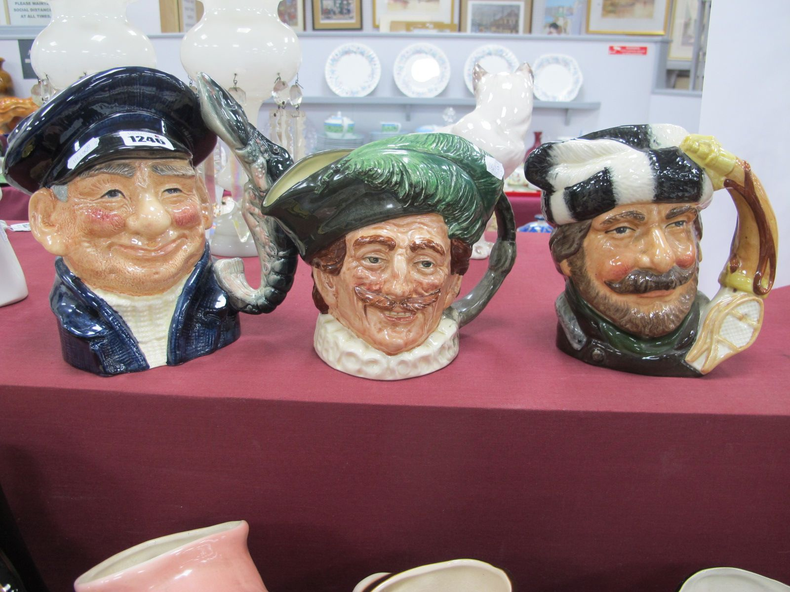 Royal Doulton Character Jugs, 'Lobster Man', 'The Trapper', 'The Cavalier'. (3)