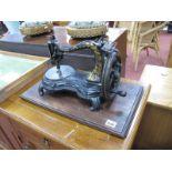 A Victorian Swan Neck Sewing Machine, with original case.