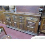 A XIX Century Walnut sideboard, with oxidized copper handles to four drawers, poker work panels to