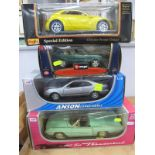 Four Large Display Diecast Vehicles, to include 1/24 Burago, Range Rover, Anson 1/8 Ford