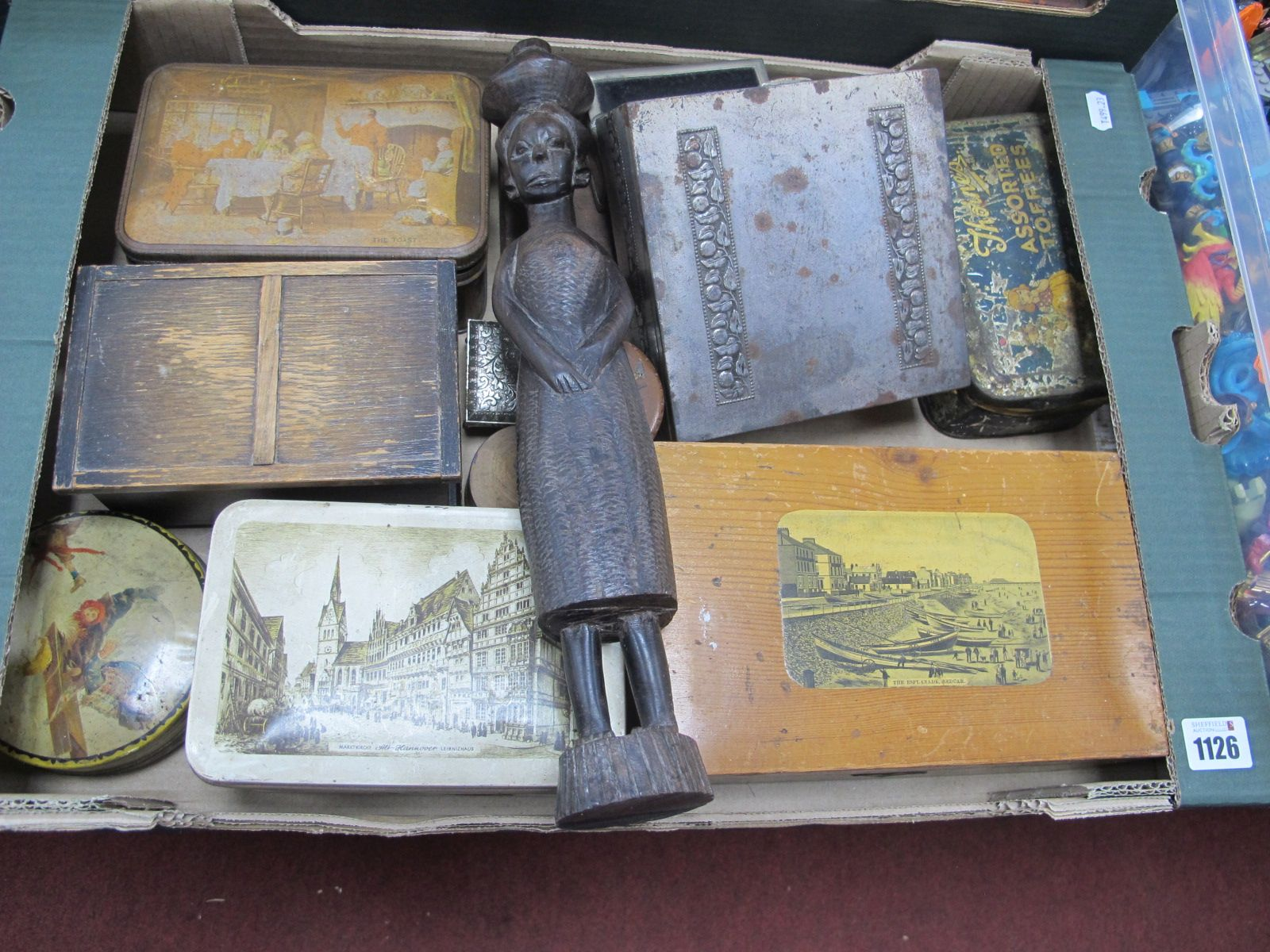 A XIX Century Pine Box, with a scene of Redcar, tins, African figure etc:- One Box.
