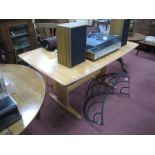 An Ercol Rectangular Shaped Dining Table, on trestle ends (with extra leaf), 200cm fully extended.
