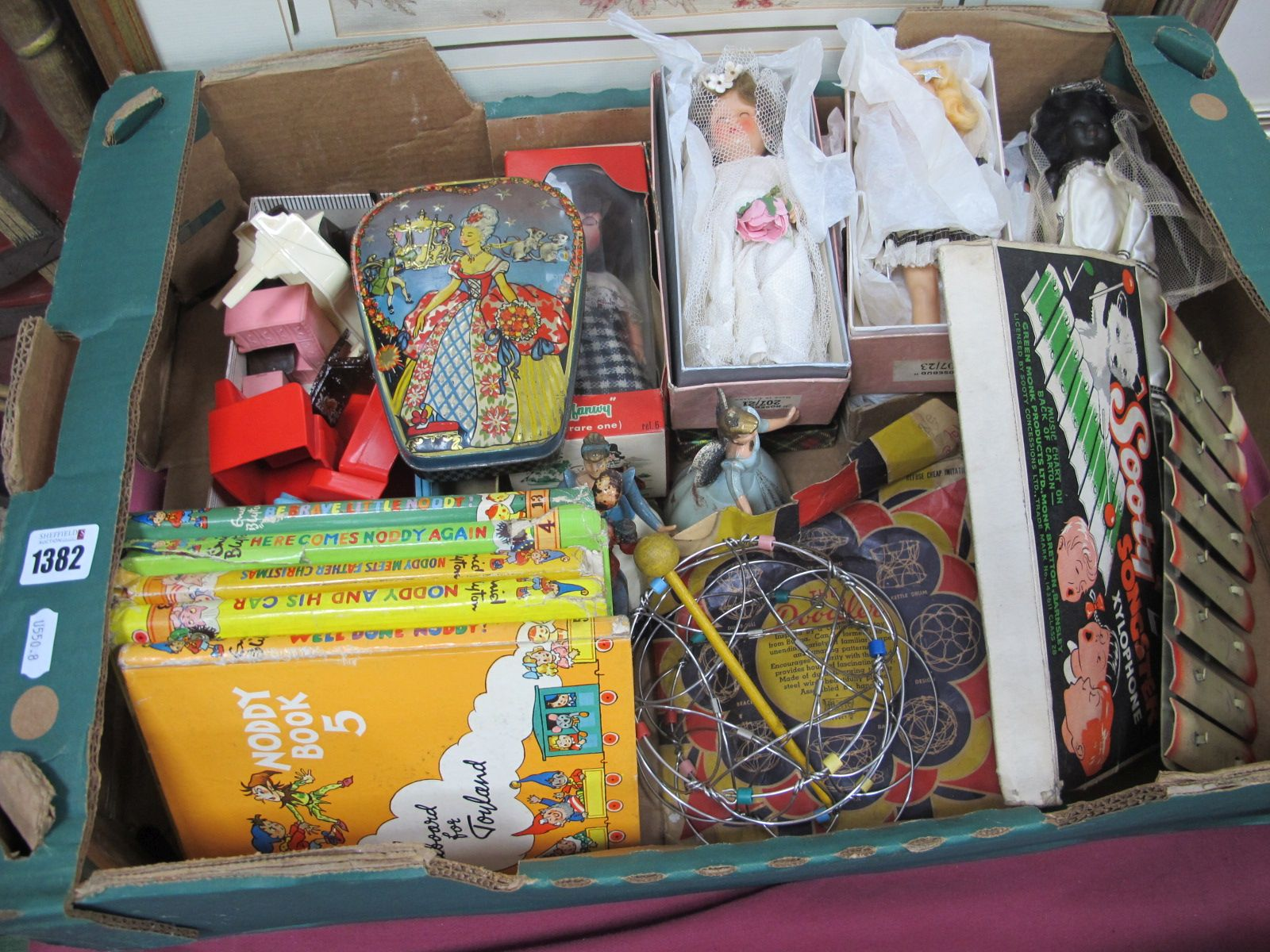 Dolls, The Doodler puzzle, Noddy books, Sooty xylophone, etc:- One Box.