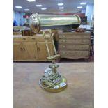 A XX Century Brass Desk lamp, on a circular base.