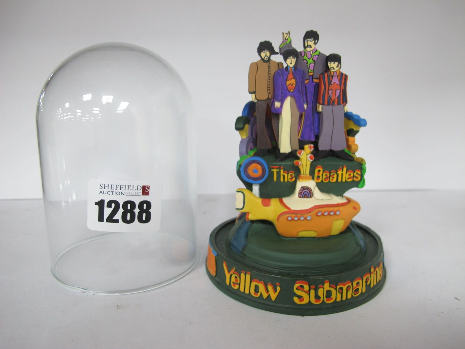 The Beatles Franklin Mint 'Yellow Submarine' Model, under glass dome 11cm high.