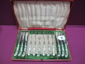 A Decorative Set of Six Ceramic Handled Knives and Forks, highlighted in green depicting birds (
