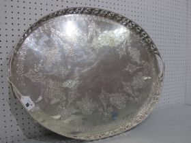 A Large Decorative Oval Plated Tray, allover foliate decorated, within gallery border of cherubs and