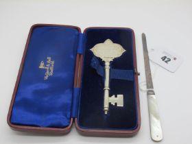 "A Hallmarked Silver Presentation Key, Walker & Hall, Sheffield 1930, inscribed ""Presented to Mr T.H."