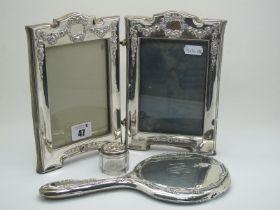 A Hallmarked Silver Freestanding Double Photograph Frame, RU&Co, Birmingham 1910, each rectangular