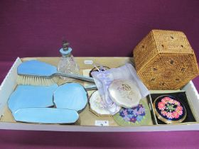 A Pale Blue Enamel Backed Part Dressing Table Set, including scent bottle and powder bowl lid (no